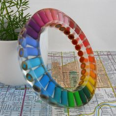 Believe it or not his is a bracelet made from colored pencils!  I just cant figure out what the clear is...