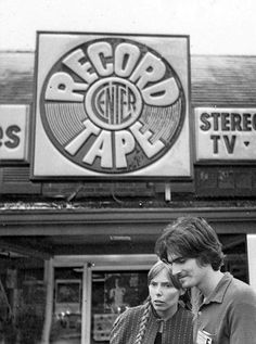 Joni Mitchell & James Taylor, record shopping at the Newport Folk Festival.