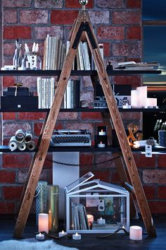 Add shelves to a step-ladder to create a vintage-inspired bookshelf. Arrange the shelves on the ladder rungs. Secure the shelves in place using nails or screws. Start creating your display. Begin from the bottom and work upwards. Remember to place heavy items in the middle and things of similar weight and size at either end.