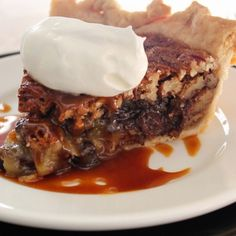 Rich Chocolate Pecan Pie - There's just something about Pecan Pie. Your guests will love this for Thanksgiving or anytime really. You can't go wrong.