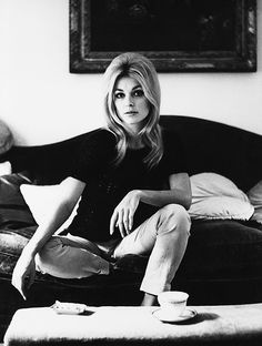 Sharon Tate settles down with a cup of tea.