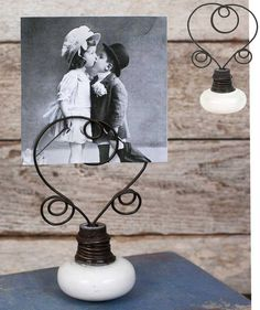 """New, made to look vintage style doorknob photo or place card holder. Great for entertaining or weddings or just to leave a note! 3¼""""L x 2""""W x 5""""T. You will receive a matching pair (2)."""