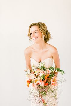 This peach floral bouquet is perfect for a fun summer wedding idea.