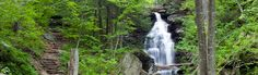 A hiking trail climbs near the waterfall Ozone at Ricketts Glen State Park, Pennsylvania.