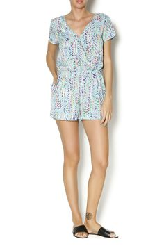 Multi printed aqua romper with cross front top. Great for casual weekends when paired with flat sandals