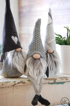 Nordic Gnome in beautiful grey plaid hat and dark grey body This listing is for one Junior Gnome SIZE: JUNIOR 12tall BODY COLOR: Dark Grey HAT : Grey plaid fabric Each gnome is handmade by me, a Scandinavian Artisan in our Brooklyn studio. Gnomes seen in NORDIKatja shop are made in small
