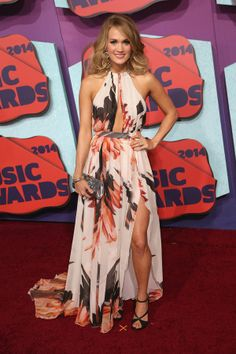 Carrie Underwood, in Roberto Cavalli, attends the 2014 CMT Music awards at the Bridgestone Arena on June 4, 2014 in Nashville, Tennessee.