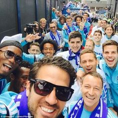 Chelsea midfielder Cesc Fabregas poses for a selfie with John Terry, Nemanja Matic and Co on the celebratory bus