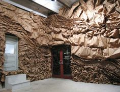 WALL CREATED WITH WAVES & RUFFLES OF BROWN PAPER