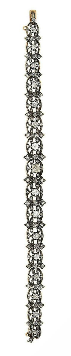A late 19th century diamond bracelet Designed as a series of old brilliant and rose-cut diamond openwork cluster articulated panels with rose-cut diamond stylised foliate connecting links, mounted in silver and gold, circa 1890, 18.0cm long