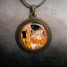Gustav Klimt's The Kiss art pendant by MoonGardenDesigns on Etsy, $12.50