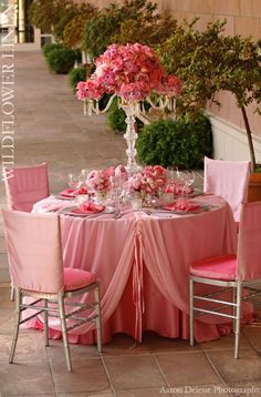 Pink floral arrangement and linens for a wedding reception