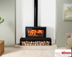 The Stovax Riva Studio 1 wood burning stove is a high performing wood burning stove only stove which has a compact, yet innovative design. With a heat output the Riva Studio 1 wood burning stove will provide ambiance and warmth. Home Fireplace, Fireplace Remodel, Modern Fireplace, Living Room With Fireplace, Fireplace Design, Fireplace Ideas, Living Rooms, Wood Burner Fireplace, Contemporary Wood Burning Stoves