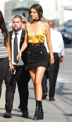 All shine: The model rocked a lacy gold nightie top while heading to the appearance