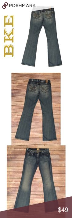 BKE Denim Sabrina Stretch 27 X 33 1/2 Boot Jeans BKE Denim Sabrina Stretch 27 X 33 1/2 Boot Cut Medium Wash Jeans Blue   ▫️No holes ▫️No stains  ▫️Light wear on back hem -shown in photos   ▫️Measurements in photos  ******ACTUAL length is NOT the same as the length on the tag******* THEY ARE 1 INCH LONGER  🛍For the best deal, I offer a bundle discount! Please check out my closet for other fabulous items!🛍 BKE Jeans Boot Cut