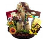 Garden of Delights-Gift BasketThis colorful spa and gourmet gift basket offers a virtual garden of delights for her to enjoy whatever the occasion!  This delightful garden of gifts, bath and body gift basket, is absolutely magnificent!  It showcases a beautiful rope basket piled high with some of our finest gourmet treats, luxurious spa products, gifts and candles, and more!  It is an amazing gift that will truly delight and spoil her! $130