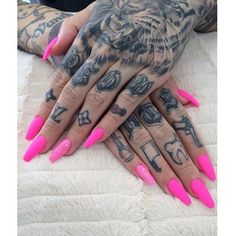 Tattoos with razor sharp looking pink nails... helps me break out of my perceptions of faux nails and pink. LOVE!