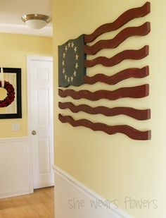 Great tutorial on how to make this awesome wooden flag - this would make a great display on any wall in the house!    www.she-wears-flowers.com