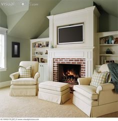 two chairs flanking the fireplace with tv