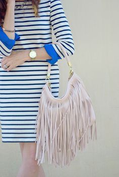 Transitioning from summer to fall can be hard on the wardrobe. Conni shows you 3 striped dress outfit ideas to head into the next season with ease.