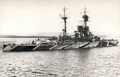 HMS Revenge, lead ship of the 15 in 'R' class, was commissioned just in time to serve at Jutland in May 1916.  She is shown here subsequently at Scapa Flow in late WW1 dazzle camouflage.  The entire 5 ship class served on into WW2 (Royal Oak being sunk in 1939), but were not as successfully modernised in the 1930s as the preceding 'Queen Elizabeths', being slower.