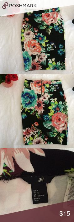 Bomb floral pencil skirt Black background with brightly colored flower print, very flattering fit with a zip back and seam down the backside. Great condition. Super stretchy says small but I'm a medium/large depending and it stretched to fit me great. H&M Skirts Pencil