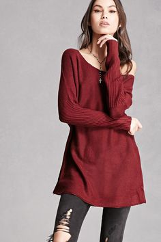 A honeycomb knit sweater featuring a longline silhouette, long dolman sleeves with a ribbed design, and a round neckline. This is an independent brand and not a Forever 21 branded item.
