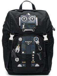 Prada Robot Stud And Leather-embellished Nylon Backpack In Black/blue Prada Backpack, Backpack Bags, Prada Handbags, Luxury Handbags, Tennis Bags, Leather Factory, Designer Handbags On Sale, Prada Men, Designer Clothes For Men