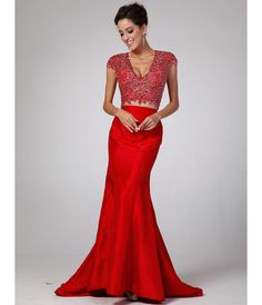 This is a stunning gown. So many elegant details. From the cap sleeve embellished crop top with cut out back to the taffeta long mermaid skirt, this dress is sure to turn heads. From unique vintage prom