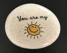 You are my sunshine stone- Decorative Stone - Rock Art- image stone - Decor Rock Painting Patterns, Rock Painting Ideas Easy, Rock Painting Designs, Pebble Painting, Pebble Art, Stone Painting, Painted Rocks Craft, Hand Painted Rocks, Painted Wood