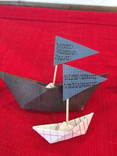 Nautical Baby Shower- mini origami boat food labels.  For these tiny boats I used tooth picks as the masts and scrapbook paper to make the boats and flags.