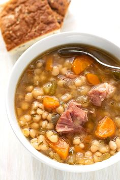 Instant Pot Ham Hock and Bean Soup is a hearty classic you can make in your pressure cooker. Great flavor! simplyhappyfoodie.com #instantpotrecipes #instantpotsoup #instantpotbeansham