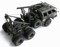 """Tamiya's 1/35 scale M 26 Armored Tank Recovery Vehicle """"Dragon Wagon"""".  The M25 Tank Transporter was a heavy tank transporter and tank recovery vehicle used in World War II and beyond by the US Army. Nicknamed the Dragon Wagon, the M25 was composed of a 6x6 armored tractor (M26) and 40-ton trailer (M15)."""
