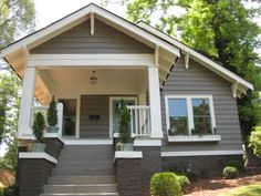 Exterior Bungalow Colors | 4-color; warm medium gray base, warm dark gray lower pillars, white porch and outer window trim, aqua door and screens.