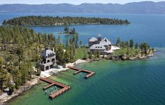 This majestic mountain aerie, Shelter Island Estate, sits atop a solid granite foundation on Shelter Island, rising from Montanas Flathead Lake; one of the top 3 cleanest lakes in the world. Shelter Island Montana, Villas, Flathead Lake Montana, Bigfork Montana, Montana Lakes, Big Sky Country, Mansions For Sale, Expensive Houses, Waterfront Homes