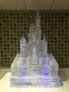 Disney castle ice sculpture with an ice luge by PSD Ice Art
