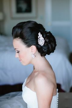 Gorgeous bridal updo.  Love the blinged out hair piece.