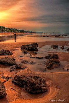 Looking along the beach at La Fontanilla, Conil de la Frontera, Spain.