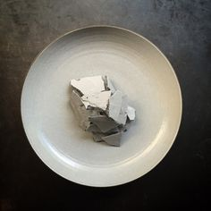 """Broken grey-scale flagstone"" dish: Goose liver, long pepper & meringue by Atsushi Tanaka at Restaurant A.T"
