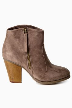 Our favorite fall essential! A taupe ankle boot to pair with every look this season for a stylishly chic accent