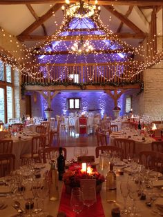Purple uplighters and red table runners
