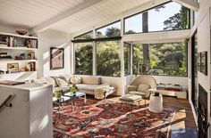 Torres Residence living room after renovation. Love the fabulous rug and beige furniture. Against that window wall, what else do you need?