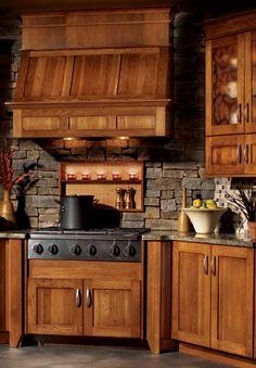 Wood range hood with stacked stone backsplash