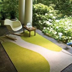 paint a piece of canvas drop cloth with porch paint for a cute porch rug