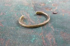 """If a bolder, weighty design suits your wrist, we also craft our hand-forged  cuffs in heavyweight styles that measure about 1/16"""" thicker than the  standard silhouette.Before leaving our shop, every piece is stamped with  the Studebaker Makers mark, and its place of origin – Pittsburgh.  Studebaker Metals crafts each high-quality piece from solid American brass,  sterling silver, or copper.Choose a high-polished finish or our uncoated  and unpolished work patina, both will evolve over time..."""