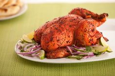 This Traditional Tandoori Chicken Indian recipe is full of flavor and juicy. Not only is it delicious it looks beautiful on the dinner table. Make sure you take a picture and post it on Facebook!