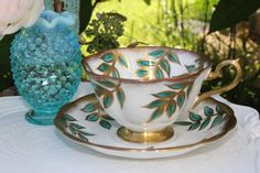 Royal Albert: Fabulous white tea cup and saucer with green leaves!