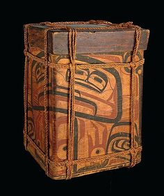 This painted bentwood storage box shows the typical lashing and knotwork of twisted cedar bark cordage used to secure the contents during transport in freight canoes. Collected on Haida Gwaii before 1901 by Charles F. Newcombe.