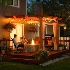 Dream Back Porch - the lights, the fire pit, the curtains. SO relaxing!