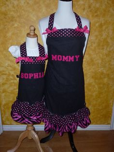 OK - Seriously - I can't wait for my little girl to be old enough for this!! Mommy Daughter apron set. $52.00, via Etsy.